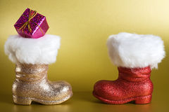 Santa Boots with Gift Stock Photos