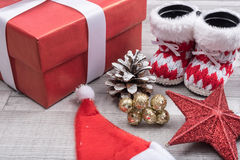 Santa boots and gift Royalty Free Stock Images