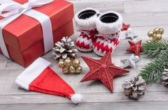 Santa boots and gift Royalty Free Stock Photography