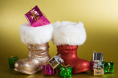 Santa Boots with Gifts Stock Images