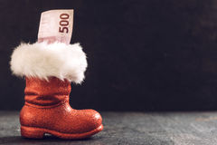 Santa boots with money Royalty Free Stock Photos