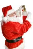 Santa bourrant des bas Images stock