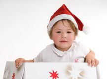 Santa in a box. Portrait of little girl in santa's hat Royalty Free Stock Photo