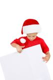 Santa boy with blank banner for greetings Stock Images
