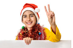 Santa boy child victory sign billboard Royalty Free Stock Image