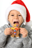 Santa boy with Christmas cookie Royalty Free Stock Photography