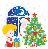 Santa and Boy with Christmas gift Royalty Free Stock Photography