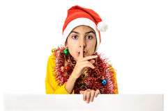 Santa boy finger over lips quiet sign Royalty Free Stock Photos