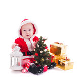 Santa boy. Little Santa boy with lantern, christmas tree and gift boxes isolated on white Royalty Free Stock Photo