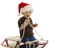 Santa Boy on Sled Stock Photography