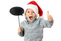 Santa boy with thumbs up Royalty Free Stock Image