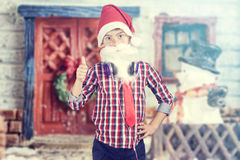 Santa boy wearing headphones Royalty Free Stock Images