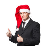 Santa businessman showing thumbs up. Isolated background Stock Photo