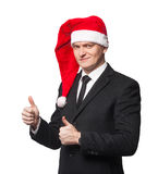 Santa businessman without smile showing thumbs up. On white background isolated Stock Photography