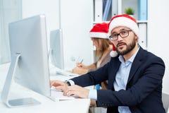 Santa businessman at work Stock Photos
