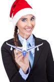 Santa businesswoman  holding  plane Stock Photos