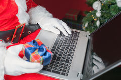 Santa buying gift by online payment through the Internet Banking Stock Image