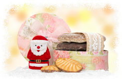 Santa and cake in box with snow frame Royalty Free Stock Images