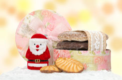 Santa and cake decorated with ribbon in box Stock Photo