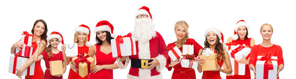 Santa calaus and happy women with gift boxes Stock Images
