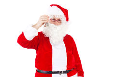 Santa calling up the christmas elves Royalty Free Stock Photos