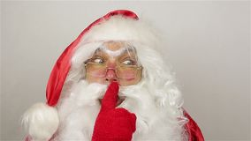 Santa calms the audience. On grey background stock video