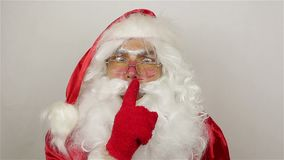Santa calms the audience. On grey background stock footage