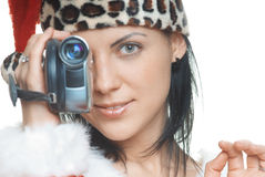 Santa with camcorder. Woman in Santa Claus costume using video camera on a white background Royalty Free Stock Images