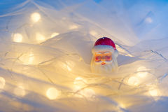 Santa candle. A Santa candle surrounding by some lights Royalty Free Stock Images
