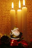 Santa in candles light Stock Photos
