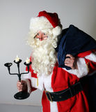 Santa with candlestick Royalty Free Stock Image