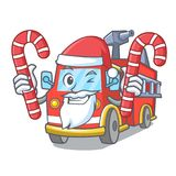 Santa with candy fire truck mascot cartoon. Vector illustration Royalty Free Stock Images
