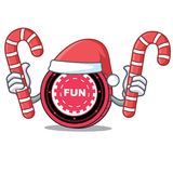 Santa with candy FunFair coin mascot cartoon. Vector illustration Stock Photo
