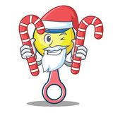 Santa with candy rattle toy mascot cartoon Stock Photo
