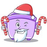 Santa with candy rice cooker character cartoon Stock Photo