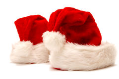 Santa cap. Red and white Santa Claus hat on a white background Stock Photos