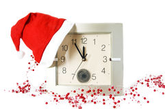 Santa cap on clock and Christmas decoration Stock Image