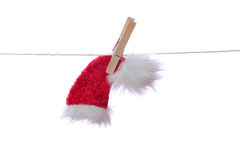 Santa cap hanging on rope Royalty Free Stock Photo