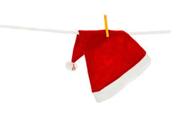 Santa cap hanging on white rope Stock Images