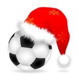 Santa cap over ball Royalty Free Stock Photo