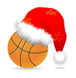 Santa cap over basketball Royalty Free Stock Image