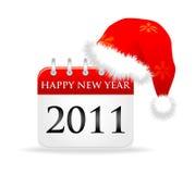 Santa cap over calendar 2011 year Royalty Free Stock Images