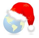 Santa cap over earth globe Royalty Free Stock Photo
