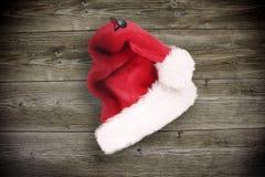 Santa cap on wood Royalty Free Stock Photo
