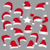 Santa caps and christmas decorations. Royalty Free Stock Image