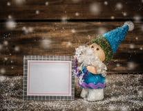 Santa with card. Royalty Free Stock Image