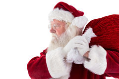 Santa carries his red bag Stock Photos