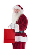 Santa carries red gift bag Royalty Free Stock Images