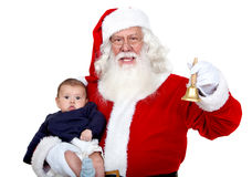 Santa carrying a baby Royalty Free Stock Photo