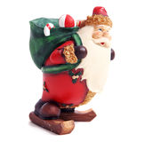 Santa carrying a bag stock photo